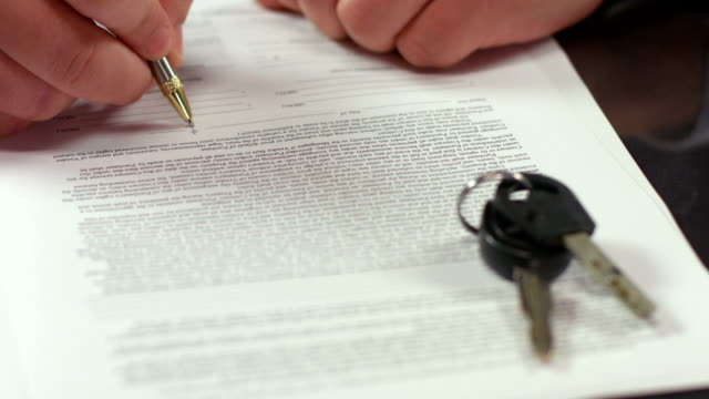 stockvideo's en b-roll-footage met man signing document, concluding rent agreement, guy buying car - gefabriceerd object
