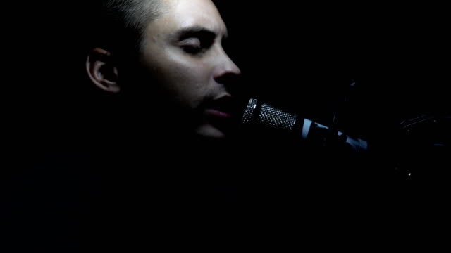 Man singing In Recording Studio with microphone. video
