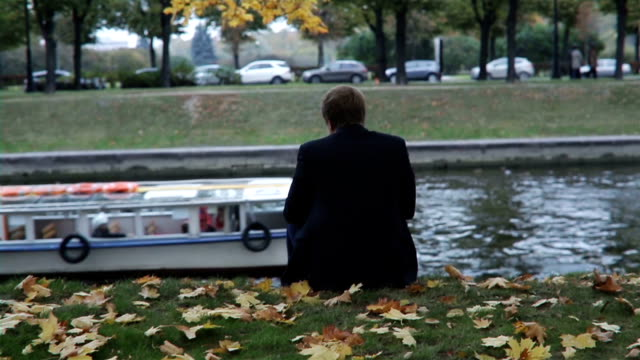 Man Sits On The Bank Of The Canal video