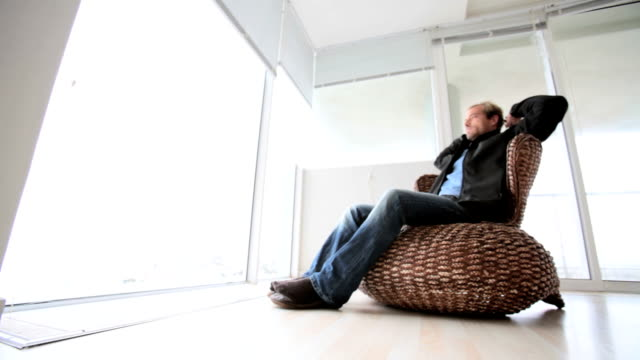 Man sits relaxing video