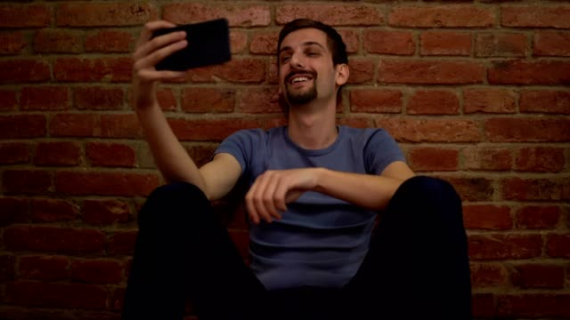 man sitting and using his mobile phone - miroslav mitic stock videos and b-roll footage