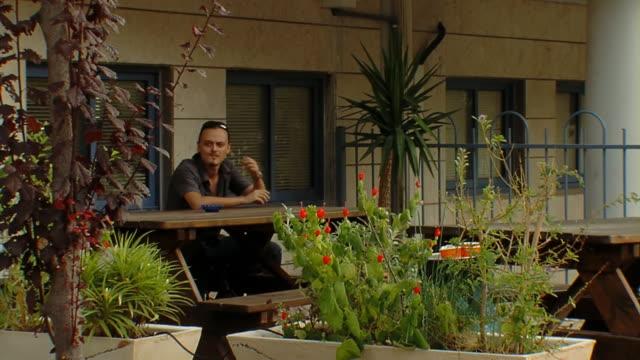 Man sitting in caffe terrace video