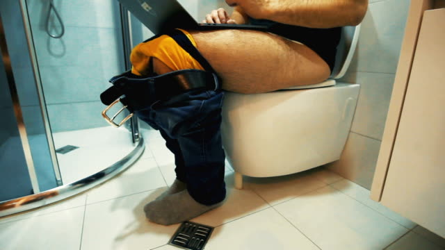 Man Sitting On Toilet Use laptop Man Sitting On Toilet Use laptop bathroom stock videos & royalty-free footage