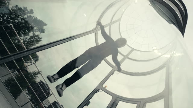 Man skydiver flies in wind tunnel. Flying in a wind tunnel. Extreme sports video