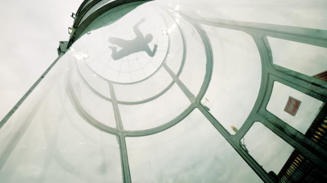 Man skydiver skydiving in an indoor arena. Flying in a wind tunnel video