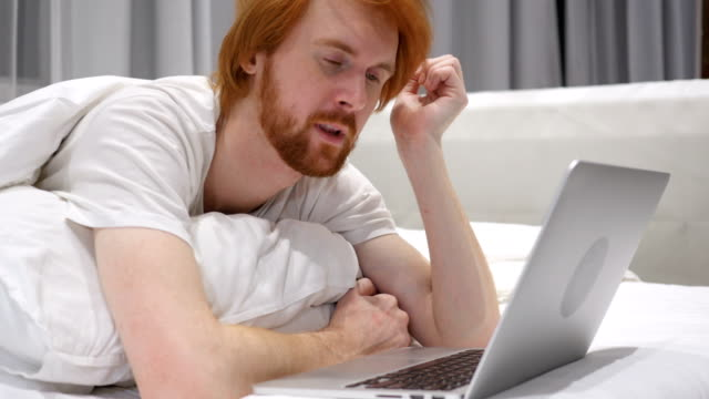 Man Sleeping in Bed Working Laptop in Bed video