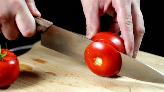 SLO MO Man slicing tomato video