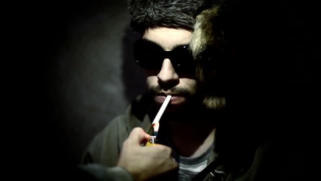 Man smokes video