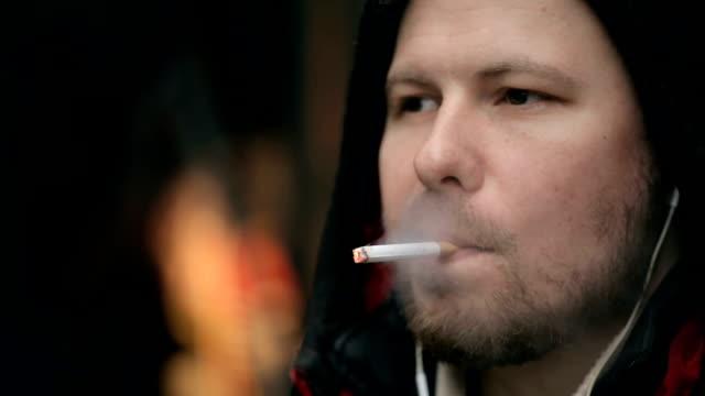 Man smoking a cigarette video