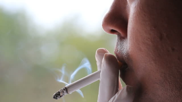 Man smoking cigarette closing shot video