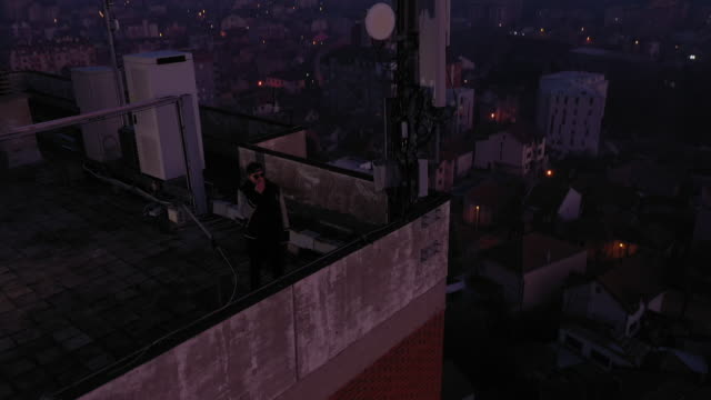 Man smoking the cigarette on the rooftop
