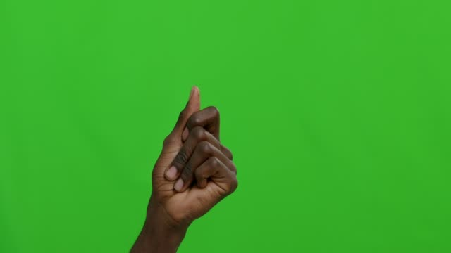 Man snapping his fingers over chroma key background Black man snapping his fingers over green chroma key background. 4k snapping stock videos & royalty-free footage