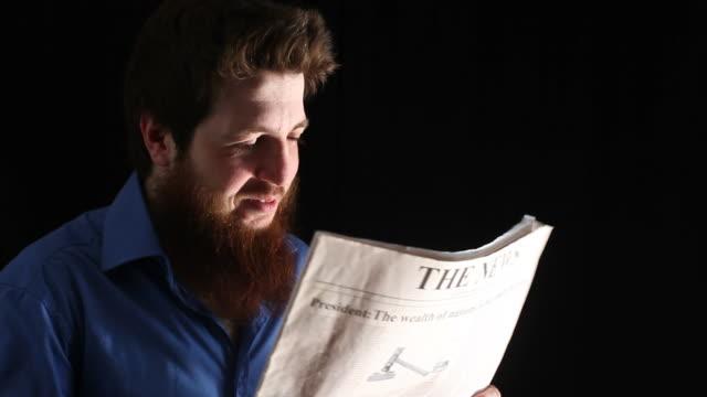 Man sneezing while reading newspaper video