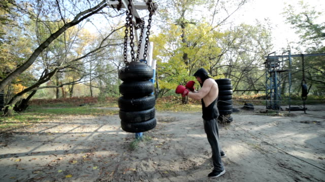 Man sports a boxer. Male athlete training, he boxes a pear. explosive stock videos & royalty-free footage