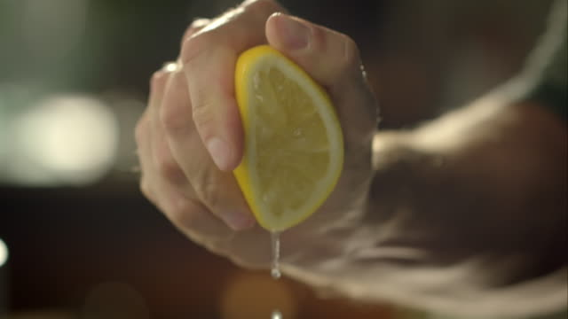 Man squeezing lemon video