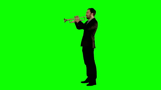 Man standing and trumpet melody. on a Green Screen video