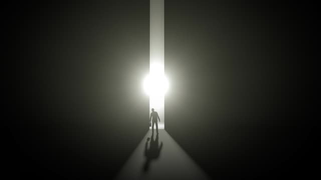 Man standing at at opening glowing door in darkness light rays coming trough and his shadow chance stock videos & royalty-free footage