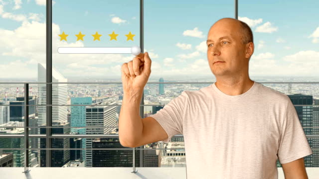 A man standing in a modern office with panoramic windows sets a rating on a virtual screen. Service rating 5 stars. Future technologies. City skyline outside the window. video