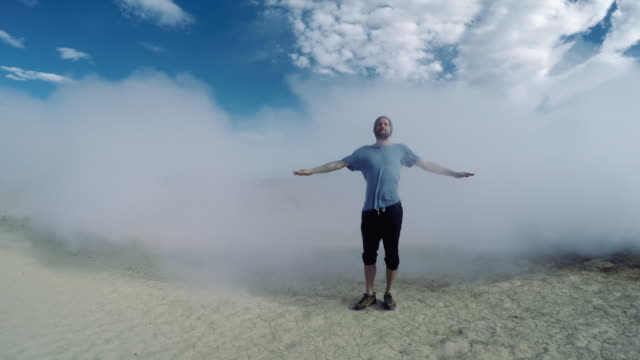 Man standing in a steam coming from Icelandic geyser. video