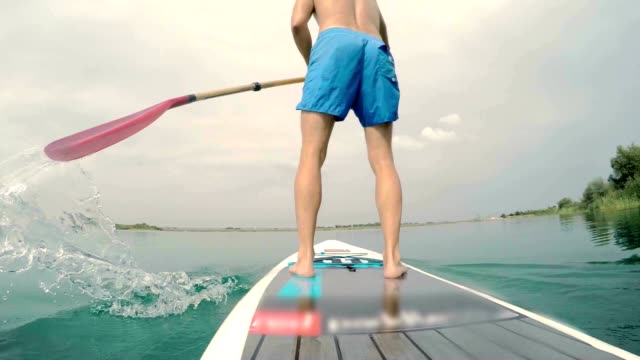 SLO MO Man stand-up paddleboarding video