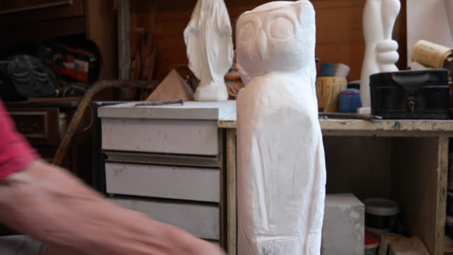 Man starting to carve the sculpture