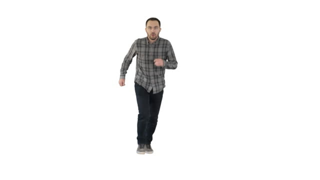 Man starting to run in casual clothes on white background