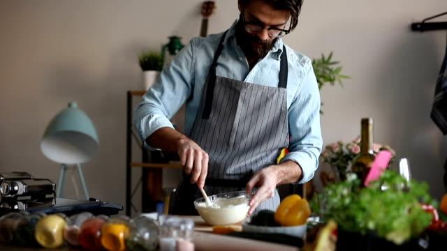 man stirring with mixing spoon - łyżka sztućce filmów i materiałów b-roll