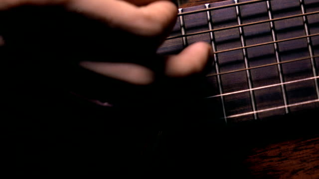 Man strumming the guitar. Music performance. FullHD macro video video