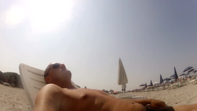 Man sunbathing video