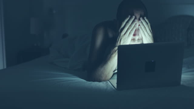 Man surfing the net late at night video