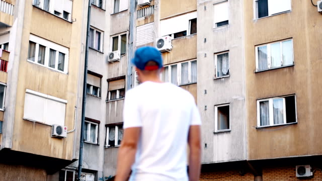 Man surrounded by buildings video