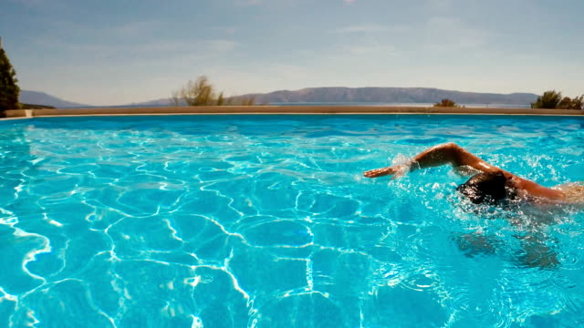 Man Swimming in a Resort Swimming Pool video