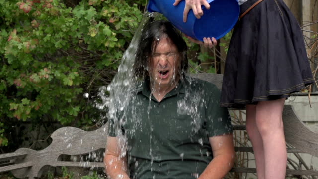 Man takes ice bucket challenge - slow motion video