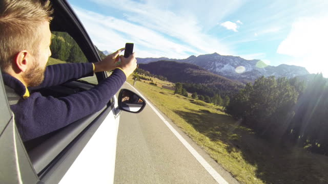 Man takes picture from moving car using digital tablet video