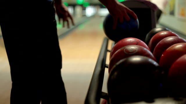 Man taking a bowl and going for a strike video