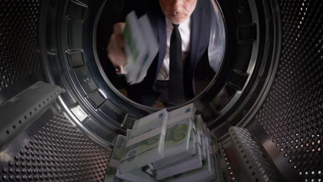 POV Man taking Euros out of a washing machine video