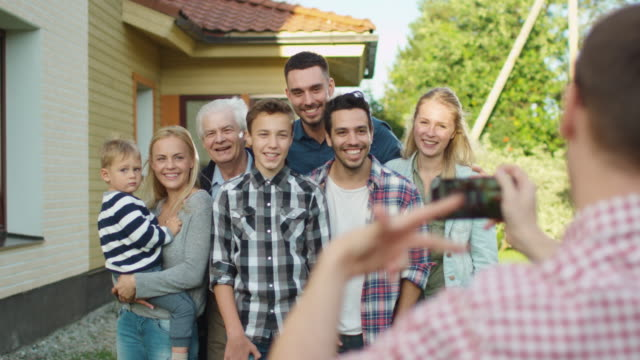 Man Taking Outdoor Photos of His Big Family. video