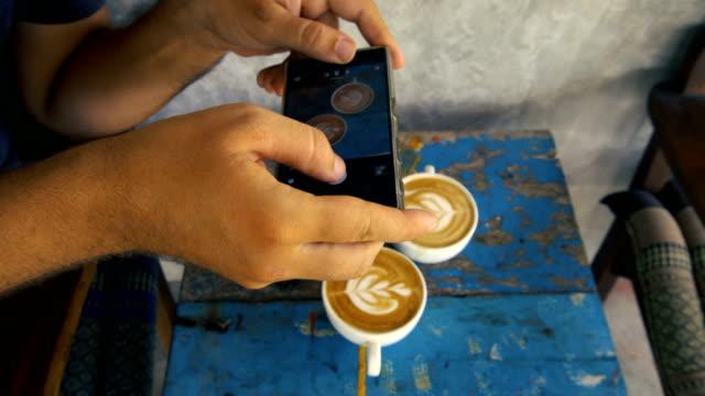 Man Taking Photo of Coffee video