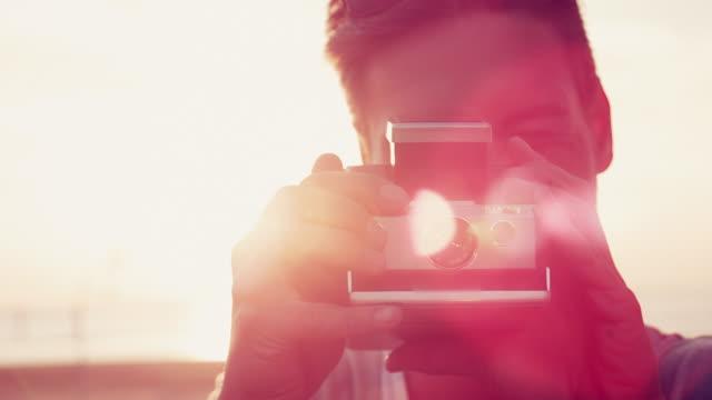 man taking photo - polaroid stock-videos und b-roll-filmmaterial