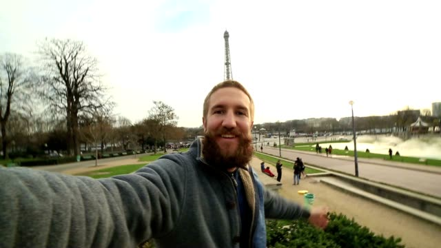 Man taking selfie at the Eiffel tower in Paris, France video