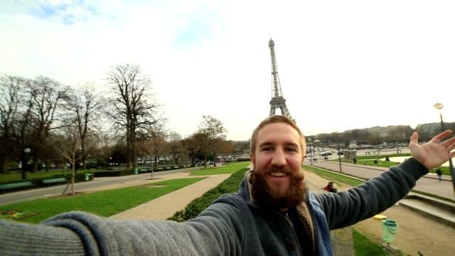 Man taking selfie at the Eiffel tower in Paris, France video