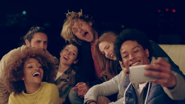 man taking selfie with friends on building terrace - terrazza video stock e b–roll