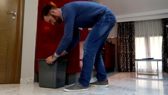 vídeos de stock, filmes e b-roll de homem tomando lixo - vídeo de estoque - junk food