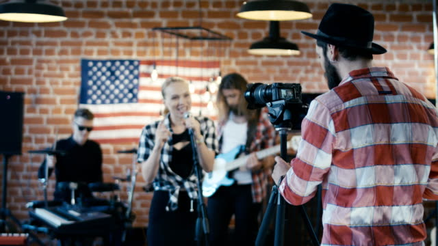 Man taking video of band show video
