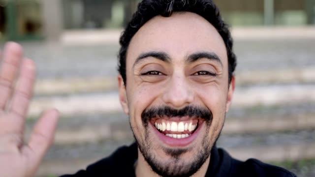 Man talking and smiling at camera during video chat