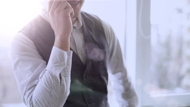 Man talking on phone with happy smile on face, successful startup company boss video