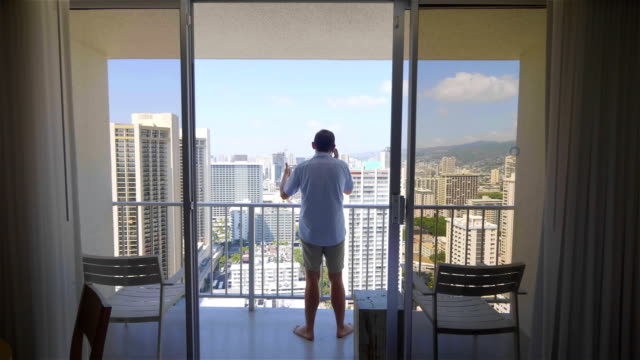 Man talking on the phone in Hawaii in 4k slow motion Professional video of man talking on the phone in Hawaii in 4k slow motion 60fps waikiki stock videos & royalty-free footage