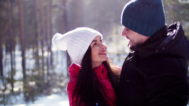 Man talking with his girlfriend in the winter forest video