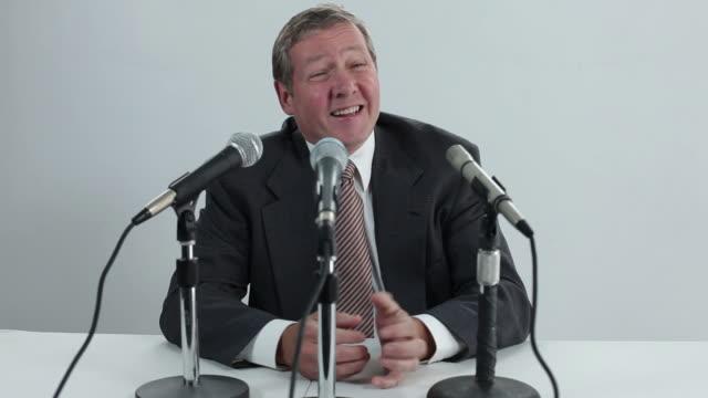 Man talks into microphones video