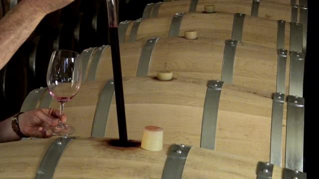 Man tasting wine in cellar, Saint-Emilion, Bordeaux Wineyard, France, video